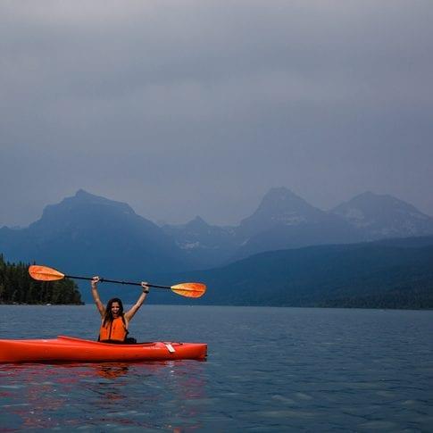 woman kayaking in glacier national park
