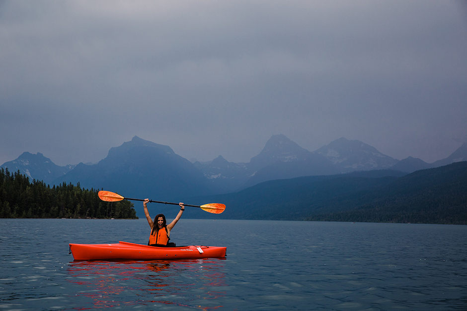 woman kayaking in glacier national park