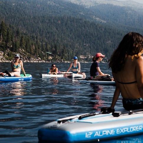 group of girls floating on lake tahoe