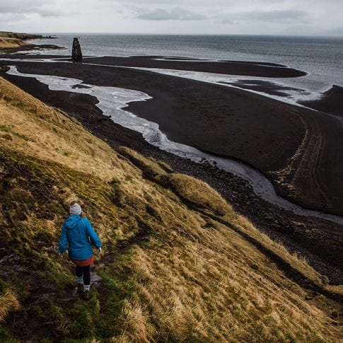 hiking to black sand beach in iceland