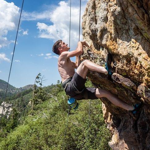 young man climbing at mount lemmon