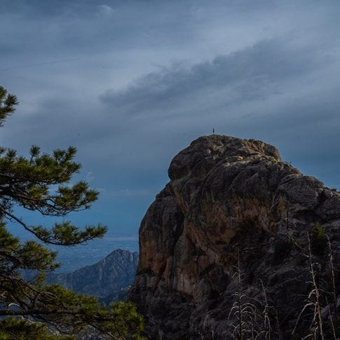 person standing far out on mountain at mount lemmon