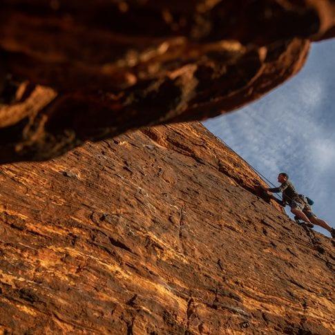 man climbing at red rocks in nevada