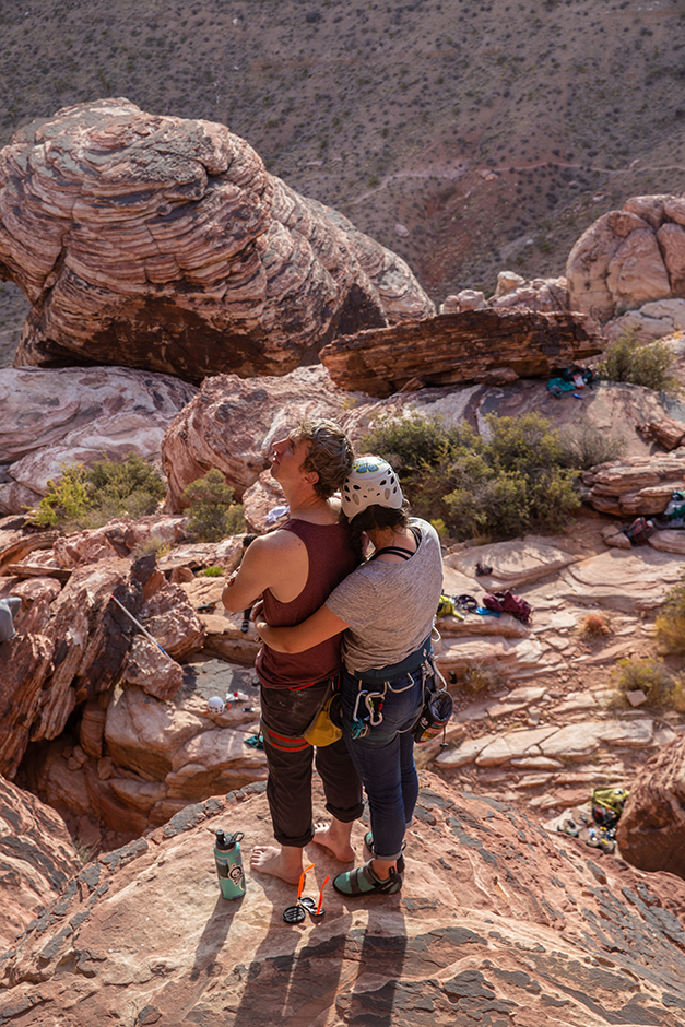 a romantic climbing couple at red rocks