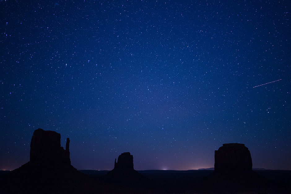 monument valley at night with starry sky